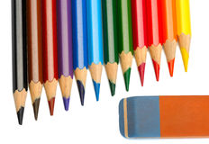 Colored pencils and eraser Stock Images