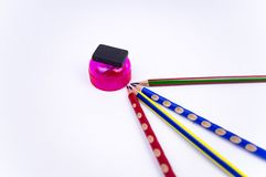Colored pencils with eraser and sharpener on a white background, there is free space to fill royalty free stock photo