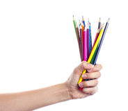 Colored pencils in a female hand on a white background . Colored pencils in a female hand on the white background Royalty Free Stock Photos