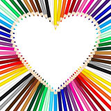 Colored pencils forming a heart frame Stock Images