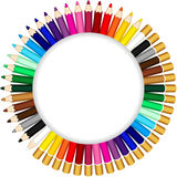 Colored pencils forming a round frame Royalty Free Stock Photography