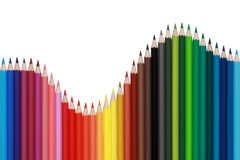 Colored pencils forming a wave. Colored pencils forming a diagram with the shape of a wave Stock Photos