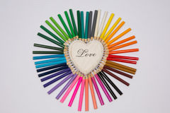 Colored pencils frame heart shaped Stock Photos