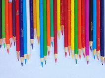 Colored pencils. Freshly sharpened colored pencils arranged in a row Royalty Free Stock Images