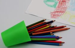 Colored pencils and funny drawing stock photo
