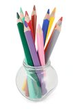 Colored pencils in a glass jar royalty free stock photos