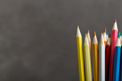 Colored pencils on gray Royalty Free Stock Photos