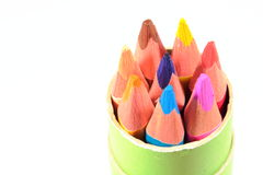 Colored pencils in the green box Royalty Free Stock Photos