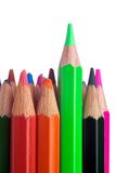 Colored pencils, with the green standing proud. Can illustrate individualism.  Isolated on pure white Stock Photography