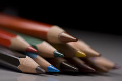 Colored pencils. Group of colored pencils with shallow depth of field on black background Stock Photo