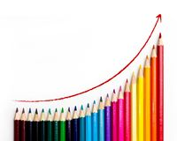 Colored pencils with growth chart. Color pencils with arrow on white background Royalty Free Stock Photography