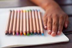 Colored pencils with hand Stock Photo