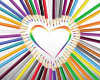Colored pencils in a heart. On a gray background Stock Images