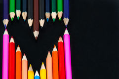 Colored pencils in heart shape Stock Image