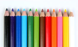 Colored pencils horizontal. Colored pencils over a white background horizontal array Stock Photography