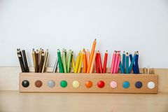 Free Colored Pencils In A Container On A Wooden Table Stock Images - 143680314