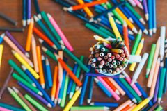 Colored Pencils In A Glass On Wooden Background Stock Images