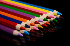Colored pencils isolated on black background with reflection Stock Photo
