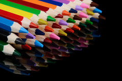 Colored pencils isolated on black background with reflection Royalty Free Stock Photography