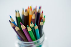 Colored pencils kept in jar Royalty Free Stock Photos
