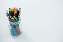 Colored pencils kept in jar Stock Photos