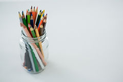 Colored pencils kept in jar Royalty Free Stock Photography