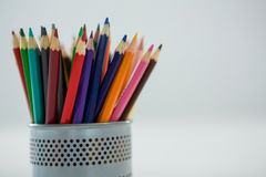 Colored pencils kept in pencil holder Stock Photos