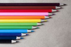 Colored pencils on the kraft paper. Colored bright pencils on the kraft paper, rainbow stairs Royalty Free Stock Photos