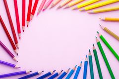 Colored pencils laid out in the form of an eye. Bright sharp pencils are ready for drawing. Abstract background from color pencils. Copy space place for stock images