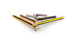 Colored pencils lie on top of each other isolated on white background Royalty Free Stock Photos