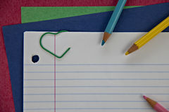 Colored pencils on line notebook paper Royalty Free Stock Photos