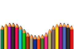 Colored pencils line up in curved row Royalty Free Stock Images