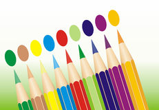 Colored Pencils Lined Up. Coloured pencils arranged in a row with spots in the same color Royalty Free Stock Image