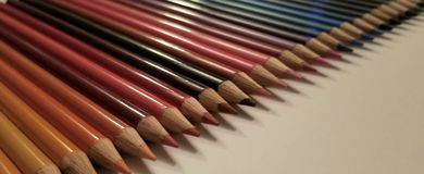 Colored pencils lined up Stock Photography