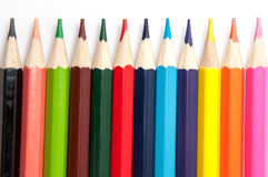 Colored pencils lined up on a white background Stock Image