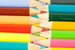 Colored Pencils lined yup. Colored pencils lined up interconnecting like a zipper Royalty Free Stock Photo