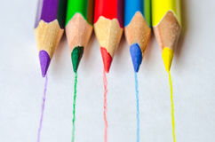 Colored pencils with lines white background. Set of colored pencils isolated against the white background. Pencils drawed lines of corresponding color. Close up Royalty Free Stock Photos