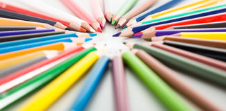 Colored pencils lying circle Stock Photos