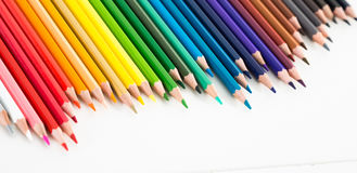 Colored pencils lying in irregular row Royalty Free Stock Photo
