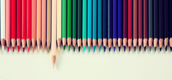 Colored pencils lying in row Stock Images
