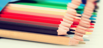 Colored pencils lying in row Stock Photos