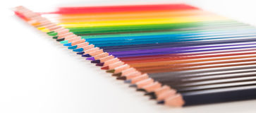 Colored pencils lying in row Stock Photography