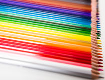 Colored pencils lying in row Royalty Free Stock Photos