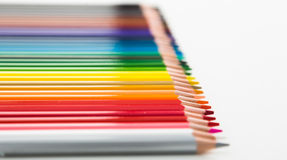 Colored pencils lying in row Stock Photo