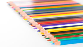 Colored pencils lying in row Royalty Free Stock Images