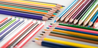 Colored pencils lying in rows Stock Photos