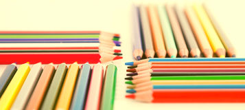 Colored pencils lying in rows Royalty Free Stock Image