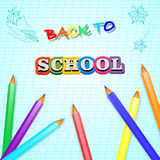 Colored pencils lying on a white sheet of paper and inscription back to school Stock Image