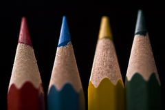 Colored pencils. Macro of group of colored pencils with shallow depth of field on black background Stock Image