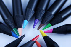 Colored pencils, macro. Colored pencils on a white background, circle shape close-up view stock photos
